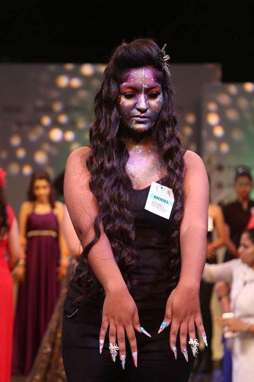 <p>A model shows off her nails on the runway at a fashion show at Professional Beauty Mumbai.</p>