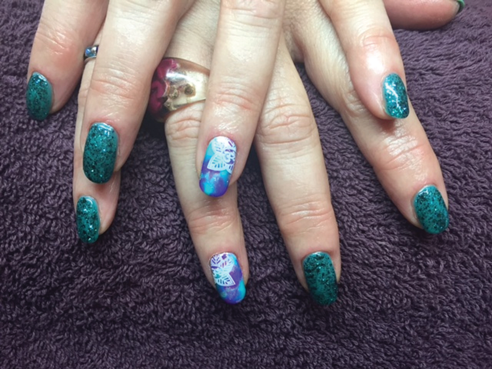 <p>Glitter gel-polish manicures are popular at The Violet Butterfly in Glastonbury, England.</p>