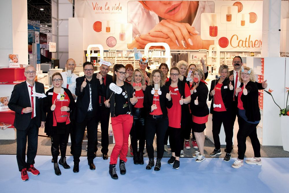 <p>Catherine Nail Collection's signature red is worn by the tradeshow team.</p>