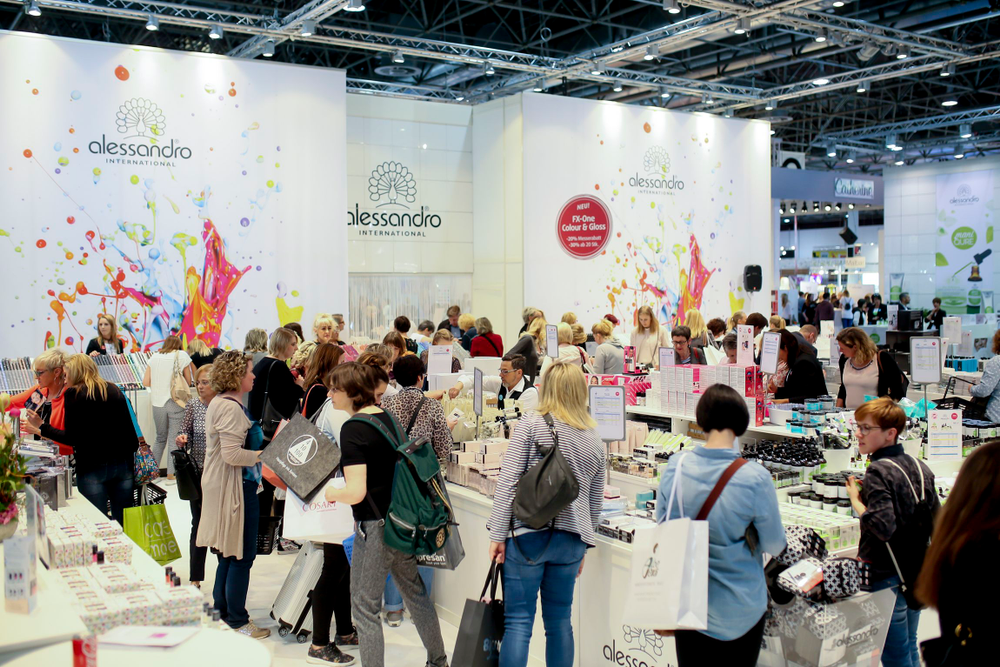 <p>Beauty Düsseldorf attendees shop at Alessandro International's booth, where the company promoted its new FX-One gel. Photo courtesy Messe Düsseldorf / Constanze Tillmann</p>