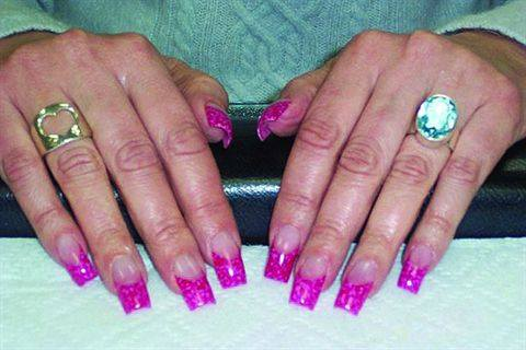<p>Elaine Watson created this set of lively Valentine's Day nails using a cotton blend fabric and clear tips.</p>