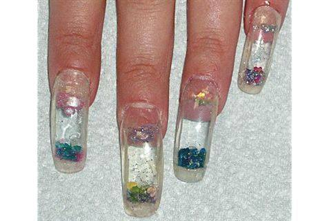 Apply the finished aquarium nail to the client's prepped nail ...