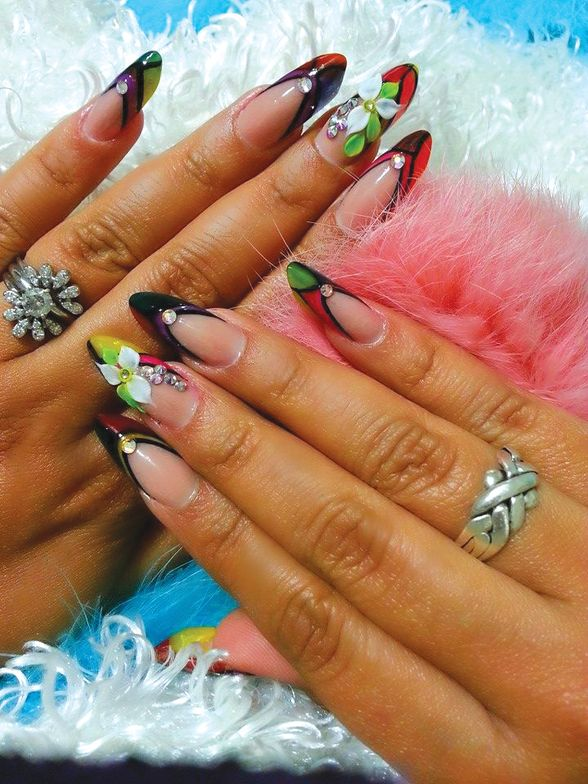 <p>Full sets of nails, like these by Triana Ramirez, complement the princess dresses worn at&nbsp;quincea&ntilde;eras.&nbsp;</p>