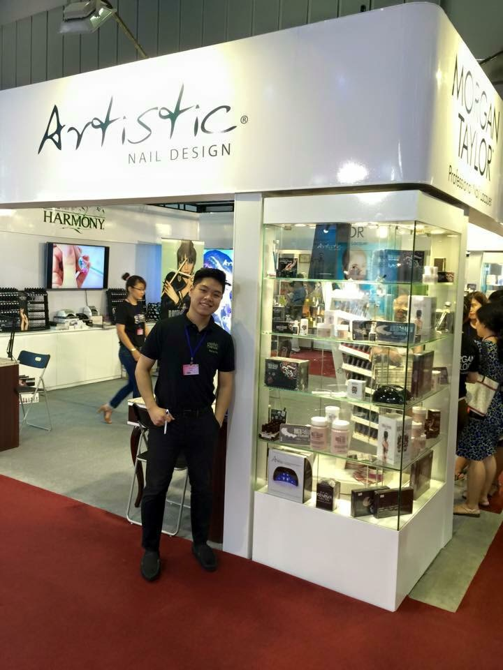 <p>Vu &ldquo;Bryan&rdquo; Nguyen Thien Nguyen, international Hand &amp; Nail Harmony educator, poses at the company&rsquo;s booth at Cosmobeaut&eacute; Vietnam.</p>