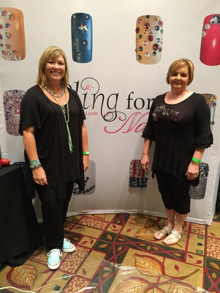 <p>June Beach (left) and Kyla Jenkins drew a lot of sparkly attention, especially for the Crystal Katana and Crystal Pixie, at the Bling for Nails Booth.</p>