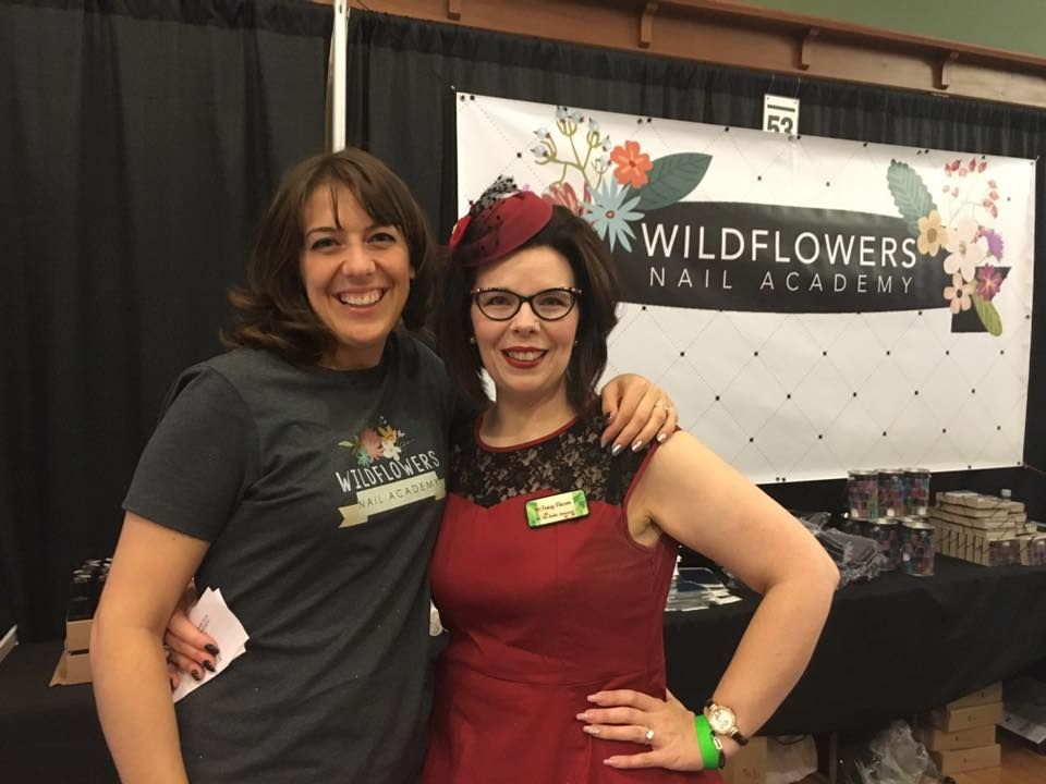 <p>Wildflowers founder Lauren Wireman (left) and artist Tracy Vinson, who demoed at her booth.</p>