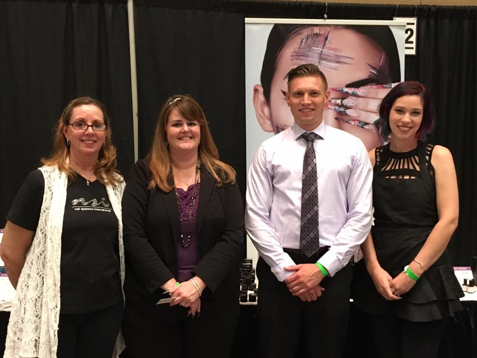 <p>The NSI Team promoted Secrets and a mix of other products. Educator Jana Warnke (far right) took home first place at the art competition.&nbsp; </p>