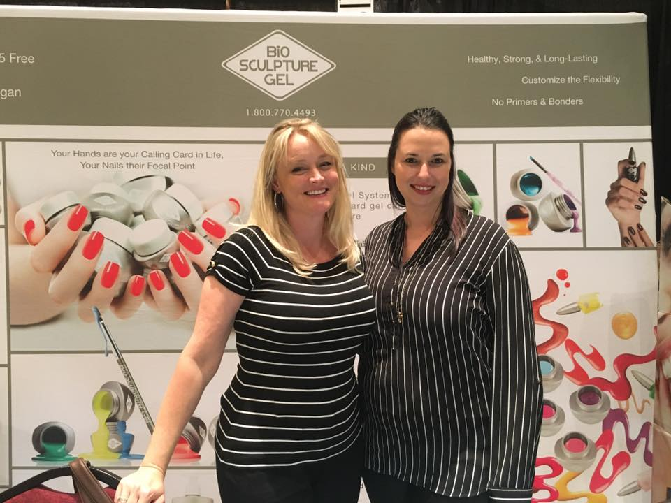 <p>Bio Sculpture Gel's Tera Sommer (left) and Melanie Visser introduced the EVO line of gel-polish at their booth.</p>