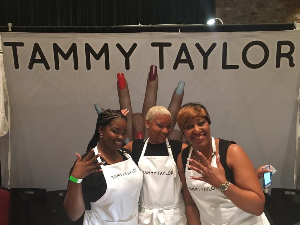 <p>(L to R) Rudy Shleton, Tamara Weeks, and Corine Hughes taught techs a dance to help remember proper acrylic application at the Tammy Taylor booth.</p>