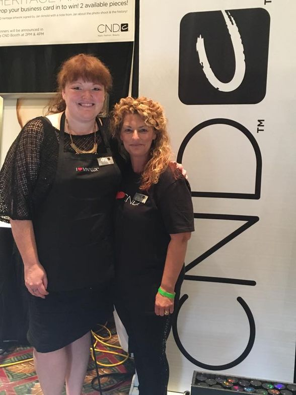 <p>CND's Holly Schippers (left) and Debbie Harris showed attendees how to use metallic additives and make nail art transfers with Vinylux.</p>
