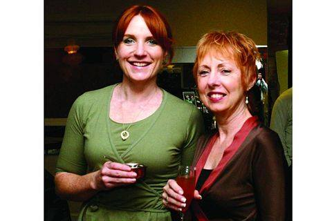 Educator Molly Grey (left) poses with Bonnie Canavino.