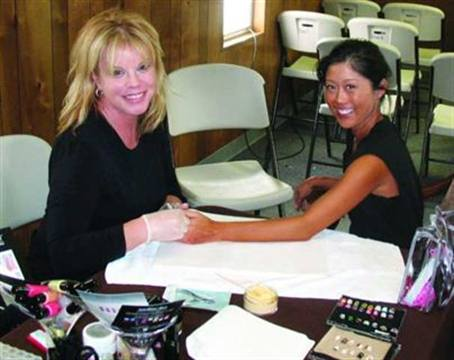 """<p>Celebrity manicurist Elsbeth used Nailtini polish to do the nails of finalists on """"Dancing With the Stars."""" Finalist Kristy Yamaguchi donned a pink and black tiger print that Elsbeth handpainted herself.</p>"""