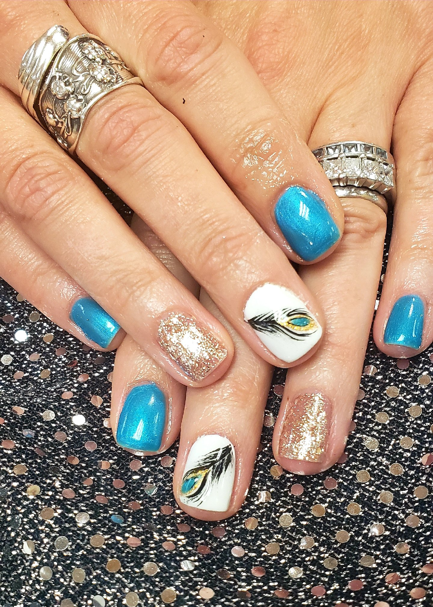 Day 99: Feather and Flower Nail Art