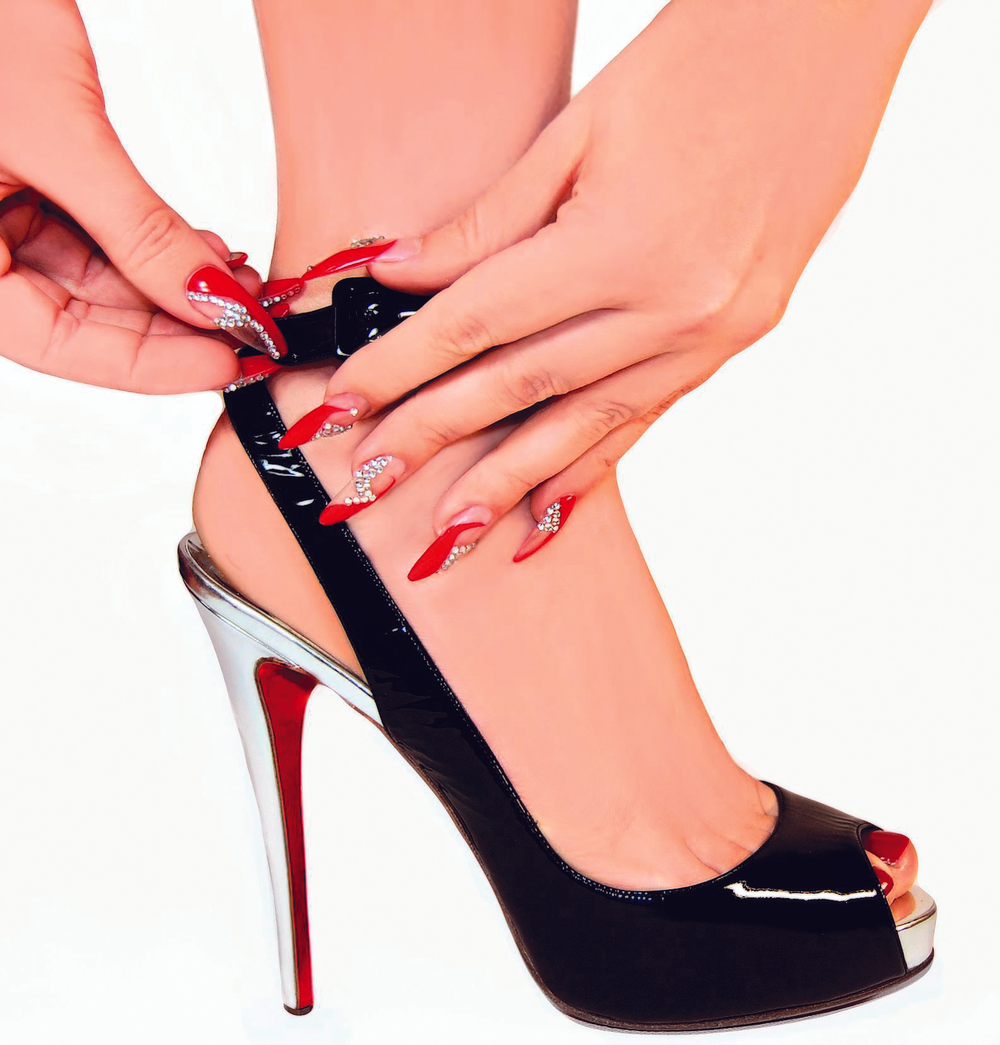 <p>About the Winner:</p> <p>A manager at The Nail Sanctuary, Kelly-Marie Daly took her inspiration for her winning image from the film &ldquo;The Devil Wears Prada.&rdquo;&nbsp; &ldquo;I found a shoe I loved and I worked the pose around my prop,&rdquo; she says. &ldquo;There are not too many poses you can do with a shoe, but I like the way the shoe had a strap, so I went with the buckling of it.&rdquo; She describes the shape as a stiletto which she rounded off &ldquo;for something a little different.&rdquo; Daly used gels from Astonishing Nails and it took her two hours to complete the set. The project was a family affair &mdash; her sister Anne-Marie Daly was the model and her cousin Sui was the photographer.</p>