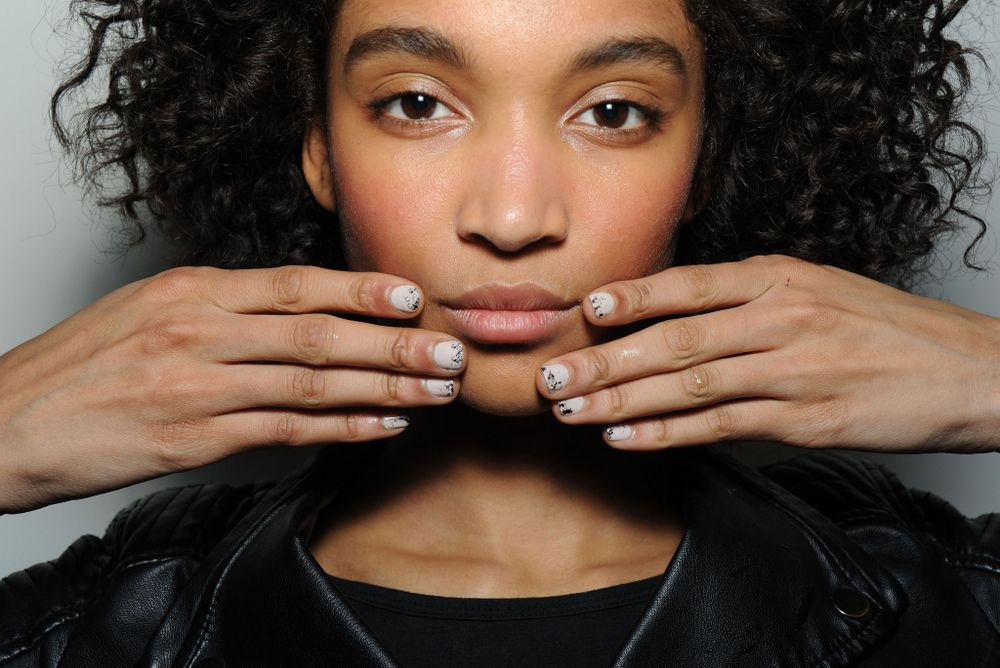 <p>Lead nail artist Danielle Candido used Morgan Taylor Birthday Suit, In the Nude, Little Black Dress, and Matte's a Wrap for Zero + Maria Cornejo</p>