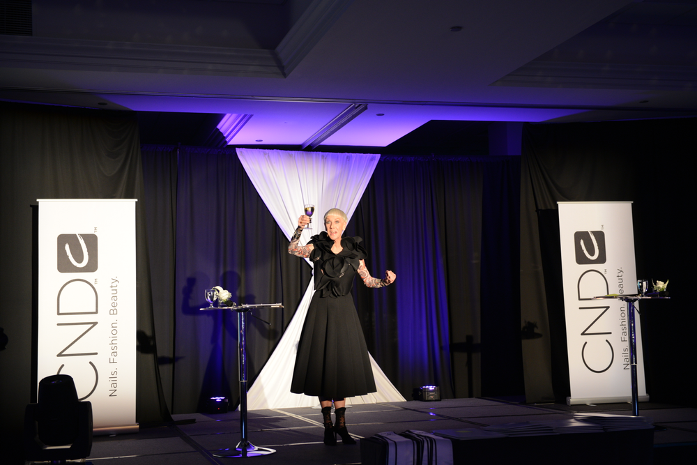 <p>Jan Arnold, CND co-founder and style director congrats new CND Ambassadors at graduation party.</p>