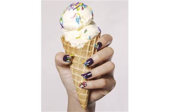 <p>2008: Jessica Marie Ellison (Nail Art Technician of the Year) took her inspiration from fashion and food. These nails are with CND Rock Royalty and embellished with real dessert sprinkles.</p>