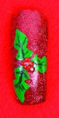 <p>Christmas: Chomanczuk combines red glitter polish with a hand-painted holly adorned with rhinestones.</p>