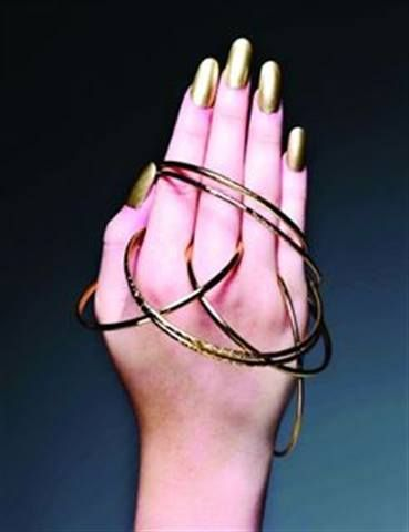 <p>2010: Jessica Marie Ellison (Nail Enhancement Artist of the Year) applied Entity gel on clear tips, with Lippmann Collection Nefertiti polish on top. She wanted to evoke the &rsquo;80s with these nails. She says she usually does a stiletto, but this time she did an oval shape.</p>