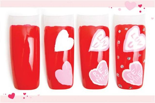 <p><strong>Fast: Nail Art in 5 MINUTES OR LESS</strong></p> <p>Be Mine</p> <p>Nails by Lam</p> <p>1. Polish the nail with OPI Big Apple Red.</p> <p>2. Paint a light pink heart and a white heart.</p> <p>3. Outline each heart with the opposite color (pink or white). Write &ldquo;Be Mine&rdquo; in one heart and &ldquo;Luv U&rdquo; in the other.</p> <p>4. Add silver glitter dots. Apply top coat.&nbsp;</p>