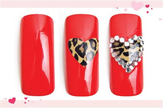 <p><strong>Fast: Nail Art in 5 MINUTES OR LESS</strong></p> <p><strong></strong>Wild at Heart</p> <p>Nails by Lum</p> <p>1. Polish the nail with OPI Red Hot Ayers Rock.</p> <p>2. Cut a heart shape out of Minx cheetah print, and adhere it to the nail like a sticker. Apply top coat.</p> <p>3. Apply rhinestones around the heart&rsquo;s border. Apply top coat.</p>