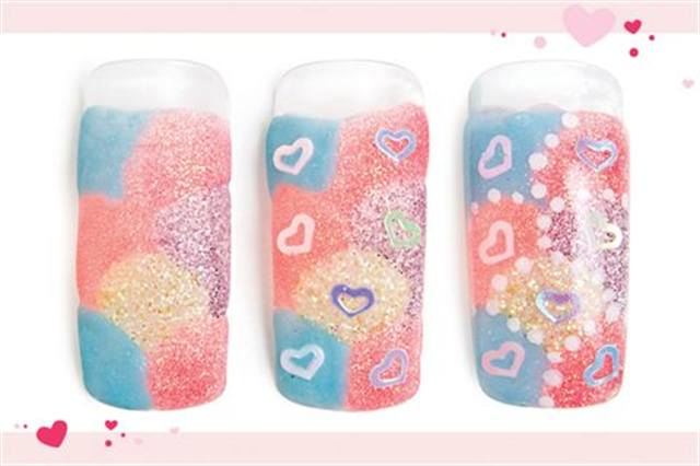 <p><strong>Fast: Nail Art in 5 MINUTES OR LESS</strong></p> <p>Heart-y Patchwork</p> <p>Nails by Rochefort</p> <p>1. Apply seven patches of colored acrylic onto the nail.</p> <p>2. While the acrylic is still wet, apply a heart decal to each section, pressing lightly.</p> <p>3. Add white polish dots along the border of each section. Cover the entire nail with clear acrylic. Shape and buff. Apply top coat.</p>