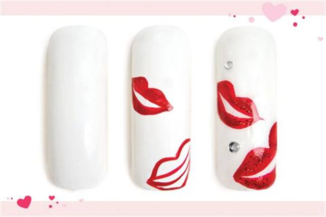 <p><strong>Faster: Nail Art in 3 MINUTES OR LESS</strong></p> <p>Hot Lips</p> <p>Nails by Jackson</p> <p>1. Polish the nail white.</p> <p>2. Using a red striper, outline the shape of two lips. Use the striper to fill in one of the lips, then the other.</p> <p>3. Add glittery red polish to both lips to add depth. Add rhinestones. Apply UV top coat. Cure.</p>
