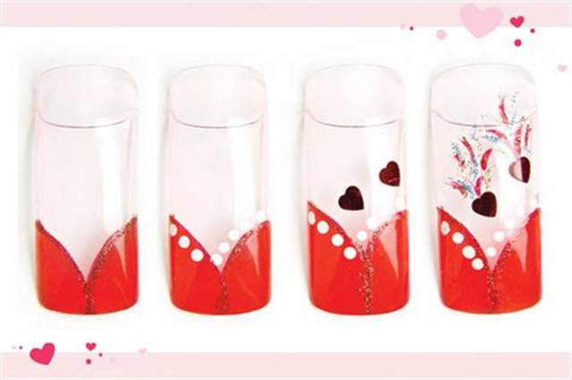 <p><strong>Fastest: Nail Art in 1 MINUTE OR LESS</strong></p> <p>Fiery Passion</p> <p>Nails by Rochefort</p> <p>1. Create a V-shaped French with a red polish tip and a translucent pink base. Apply red glitter polish to the smile line.</p> <p>2. Add nine white dots along the smile line.</p> <p>3. Attach two red heart decals at an angle.</p> <p>4. Use red glitter, blue glitter, and gold glitter stripers to create flames. Apply top coat.&nbsp;&nbsp;</p>