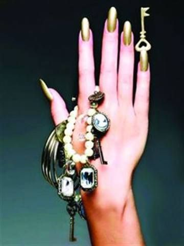<p>2010: Ashley Ann MacKenzie (Nail Art Technician of the Year) used Entity Nail Couture&rsquo;s liquid and powder, including for the sculpted key. Then, she polished the nails using Nefertiti from the Lippmann Collection.</p>