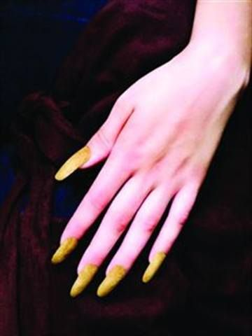 <p>2010: Ashley Ann MacKenzie (Nail Art Technician of the Year) used Entity Nail Couture&rsquo;s liquid and powder for the base, then added an appliqu&eacute; of real suede over the top.</p>
