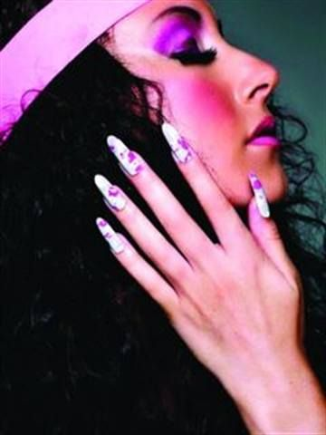 <p>2010: Ashley Ann MacKenzie (Nail Art Technician of the Year) started with Entity One Gel. She then polished the nails a dove gray, then literally splatter painted them using CND white and Hot Pop Pink polishes. She cautions that if you try this, you&rsquo;ll wind up covered in nail polish like MacKenzie was.</p>