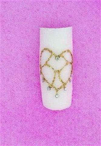 <p>Lee uses delicate gold glitter gel to create a heart-shaped mosaic.</p>