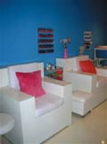 The cleaning and presentation of the pedicure and manicure areas at The Nail Lounge in Costa Mesa, Calif. (owned by Cassie Piasecki) are performed by preppers, who are paid minimum wage and given a portion of the tips for their work.