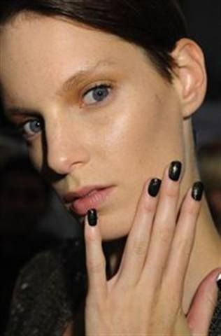 <p>At 3.1 Phillip Lim, CND&rsquo;s Oilslick was topped with asymmetrical sweeps of CND&rsquo;s Gold Sparkle for a deconstructed, oxidized finish.</p> <p><em>Photo courtesy of CND</em></p>
