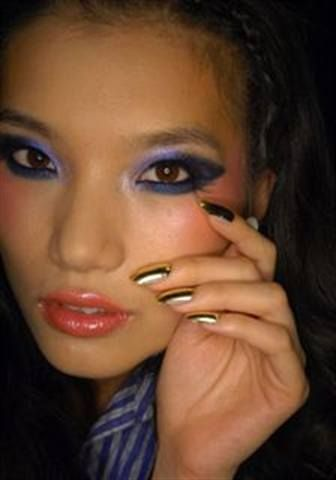 <p>The nails at Baby Phat were gold foil with CND&rsquo;s Gold Chrome topped with CND&rsquo;s Air Dry on toes for an exotic Moroccan-inspired look.</p> <p><em>Photo courtesy of CND</em></p>
