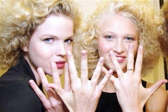 <p>Two J Mendel models show off their Dashing Diva Charlotte&rsquo;s Wedding polish.</p> <p><em>Photography by Dashing Diva</em></p>