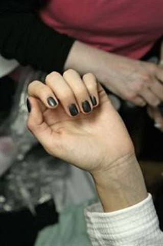 <p>Nail tech Teresa Smith polished ManGlaze Haute Mess, a matte charcoal gray polish created exclusively for the show, on the models for Gareth Pugh&rsquo;s Paris Fashion Week show. Some models also wore Pewter Metallic Minx.</p>