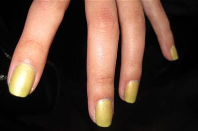 <p>At Nary Manivong, the Milani team created a matte, light lime green nail: one coat gold holographic polish, followed by one coat light lime green shimmer, and finishing it with one coat of matte top coat.</p>