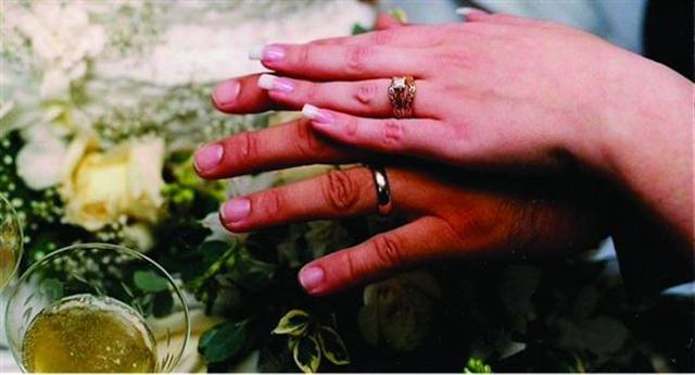 """<p>Bride: Laura Campos, Southern Accents Salon, Gainesville, Fla.</p> <p>Wedding: October 23, 1999</p> <p>""""I distinctly recall sitting at the dining room table of my matron-of-honor's house around 7 a.m. the day of my wedding doing my nails. I got them finished in plenty of time. They were simple pink-and-whites with shallow smile lines, due to the lack of time I had to do them.""""</p>"""