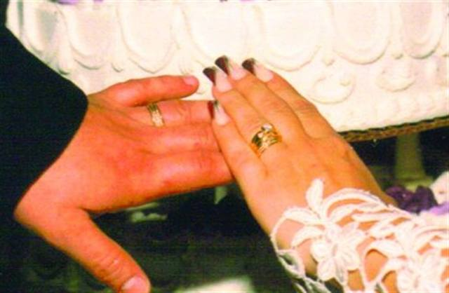 """<p>Bride: Natalie Figorotta-Frank, Utopia Salon and Spa, Westfield, N.J.</p> <p>Wedding: October 27, 1996</p> <p>""""I did my nails to coordinate with my bridesmaids' dresses. I used Essie Waltz as a base and created a French tip on an angle with OPI's Buffalo Billings Berry. I accented the design with a metallic cream and silver design with a rhinestone in each.""""</p> <p> </p>"""
