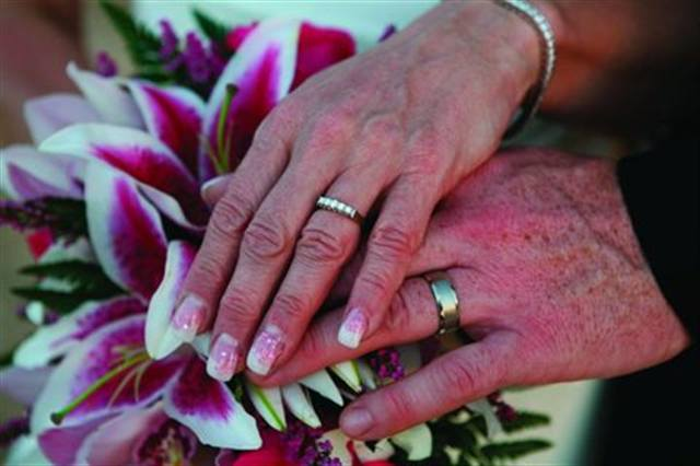 """<p>Bride: Maggie Huckerby, At Home Esthetiques by Maggie, Saskatoon, Saskatchewan, Canada</p> <p>Wedding: March 24, 2007</p> <p>""""We were married in Maui, so we had a tropical theme in the flowers and nails. I matched my nails to my bouquet, so the nails were white tips with pink stargazer lily decals on all of them."""" </p> <p>&nbsp;</p>"""