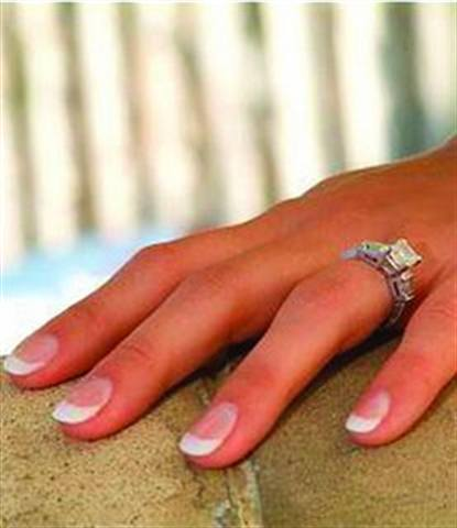 """<p>Bride: Julie Kandalec, Jenniffer &amp; Co., Mentor, Ohio</p> <p>Wedding: April 18, 2006</p> <p>""""I wore short, very oval, pink-and-white acrylics to my wedding. We got married in the Bahamas and I didn't want to be bothered with polishing them and carrying all my stuff with me!""""</p> <p>&nbsp;</p>"""