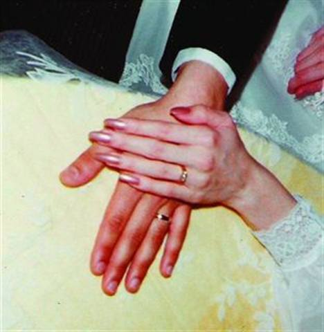 """<p>Bride: Wendy C. Updegrave, First Class Nails, East Lyme, Conn.</p> <p>Wedding: April 23, 1983</p> <p>""""I wore Vanilla Peach nail polish from Avon on my natural (long) nails.""""</p> <p>&nbsp;</p>"""