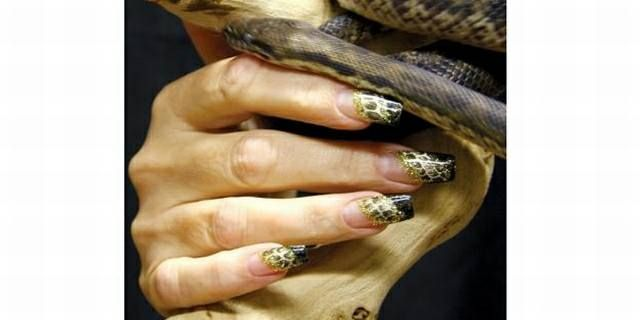 "<p>2009:&nbsp; Fuhrer used a self-adhesive foil to create the snakeskin design. The black and the glitter are <a href=""http://www.nailsmag.com/fifi/80138"">Christrio</a> color gels.</p>"