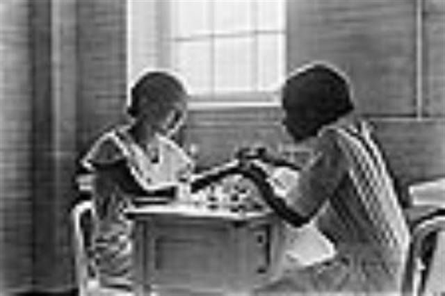 A window in time: A young woman receives training in the art of manicuring from a peer in their 1910 beauty course.