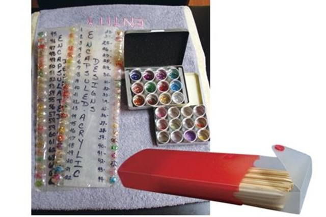<p>To keep my nail files and orangewood sticks clean and organized I use pencil boxes. To keep my acrylic colors and glitters organized I use plastic trays with individually numbered compartments to coordinate with a nail tip display I made to show off the colors. I keep everything organized in my drawers with trays.&nbsp;&nbsp;&nbsp;</p>