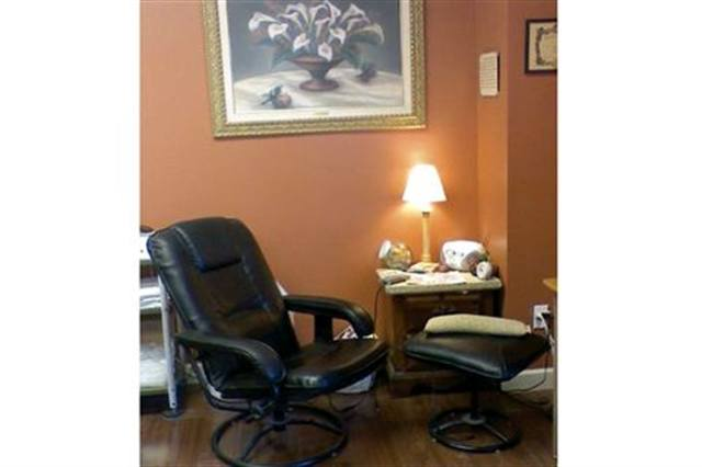 <p> The color palette of my salon is Tuscany orange with rosewood floors. I chose to use black and mustard with natural woods to accent it. The owner of the building actually chose the wall color. I get a lot of compliments about it. </p>
