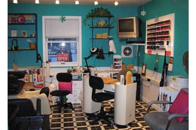 "<p>I have a cozy home-based salon that I share with my daughter Brittany (who does hair). When we built it, I wanted a cottage feel to the space, but it also had to be fun — after all, it is the Flip Flop Beauty Shop! It gets pretty gray here in the winter, so I had the lower half of the walls done in white wainscoting, with the upper portion of the walls done in a color called ""Cozumel,"" a bright turquoise. The adjacent bathroom has the same lower walls, but with a porpoise gray color on the upper walls. The floors are a checkered black, white, and gray pattern. The bright beachy colors help with those dull, dark, gray days of winter.</p>