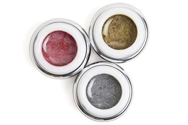 """<p><a href=""""http://www.bynubar.com""""><strong>Nubar&rsquo;s</strong></a> Infinity UV Gels have a sparkly twist this spring. The soak-off gels have six colors in the line, including Silver Sparkle, Golden Sparkle, and Loganberry Shimmer (shown here).</p>"""