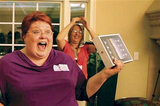 <p>Geneva Holcomb was thrilled to win the grand raffle prize from NAILS &mdash; a brand new iPad.</p>